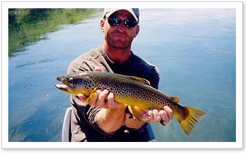Angler with big Brown trout